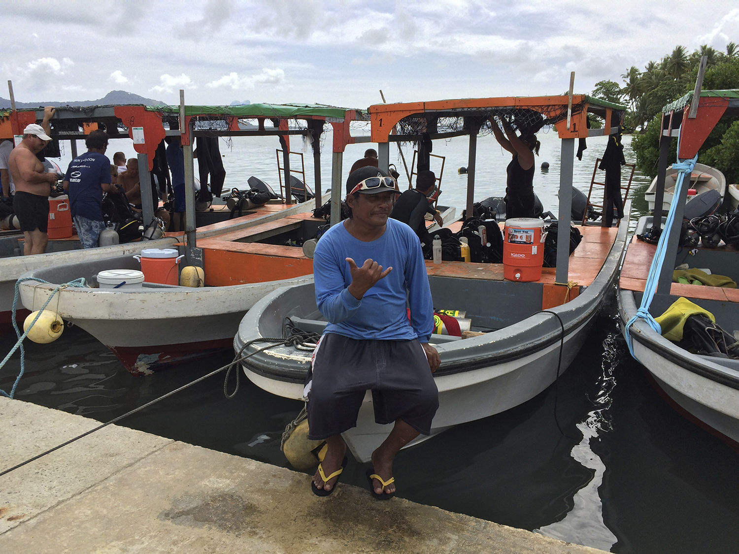 """<p>AtBlue Lagoon Resort, an employee knows to wave a """"shaka"""" to a visitor from Hawaii. The resort is one of Chuuk's rare thriving businesses, visited by tourists from Europe, Australia, New Zealand, Japan and North America.</p>"""