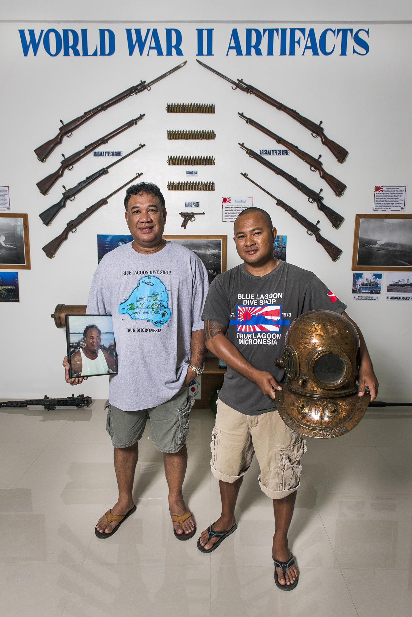 <p>Gradvin Aisek and his son, Tryfin Aisek, at the Blue Lagoon Resort dive shop museum. They are the son and grandson of the late Kimiou Aisek, the founder of the resort and dive shop.</p>