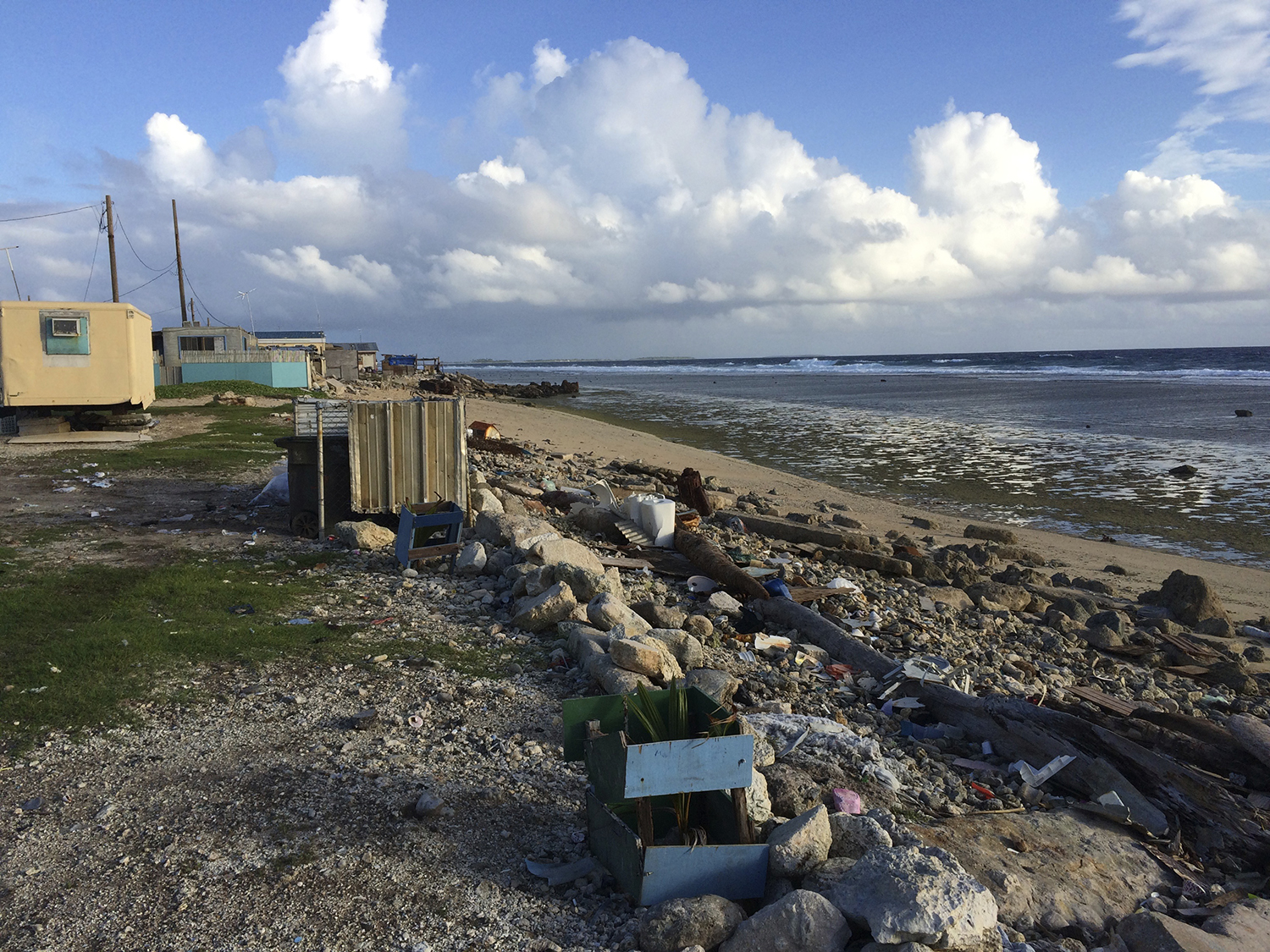<p>Poverty is widespread in Ebeye, like this ocean-side abode where litter and debris pile up.</p>
