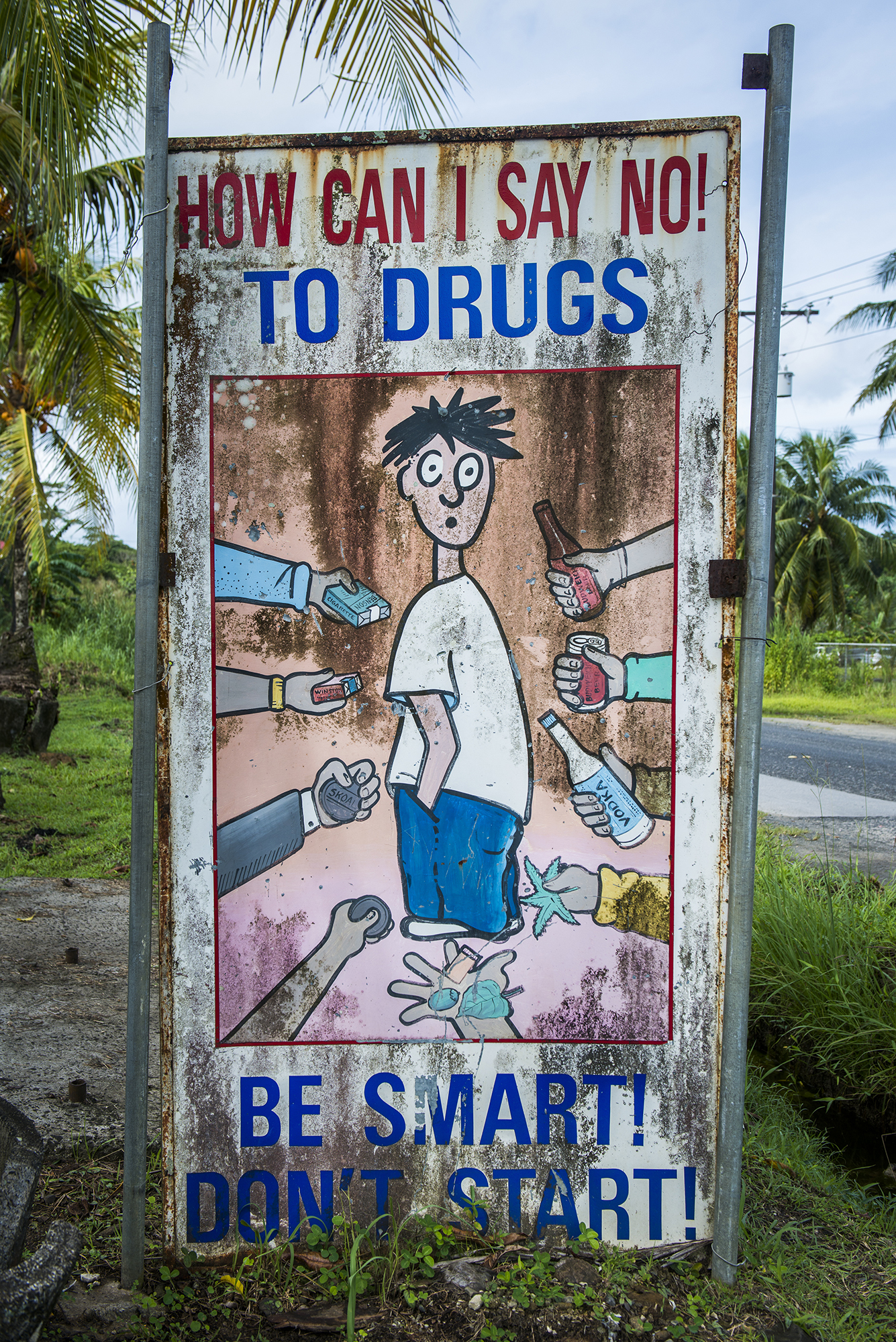 <p>A warning sign near a school indicates the serious issues many Micronesians face with substance abuse.</p>