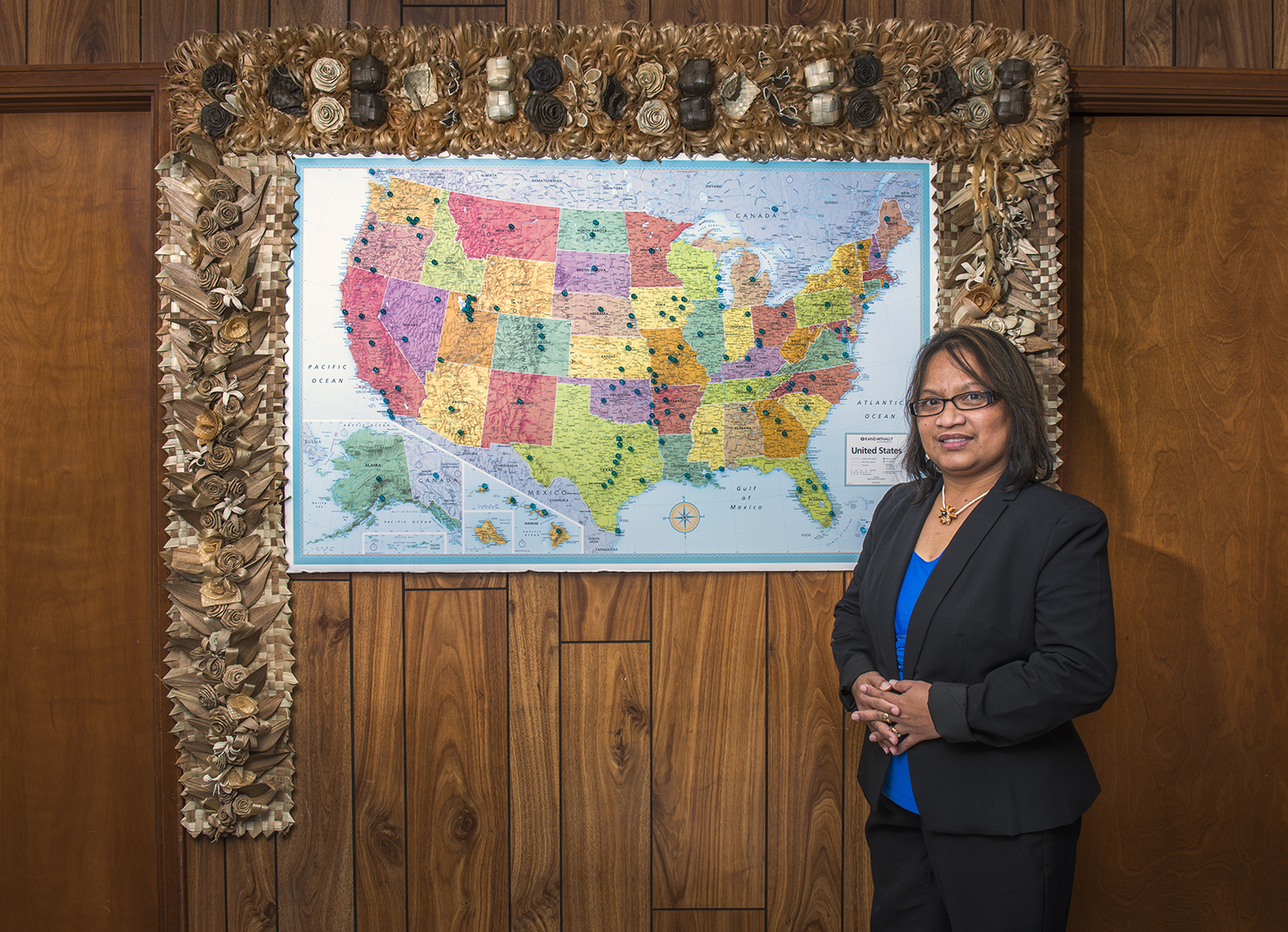 <p>Carmen Chong-Gum, the Marshallese consul general in Springdale, with a map showing where her fellow migrants now populate the U.S. It's the only American city other than Honolulu to have a Mashallese consulate.</p>