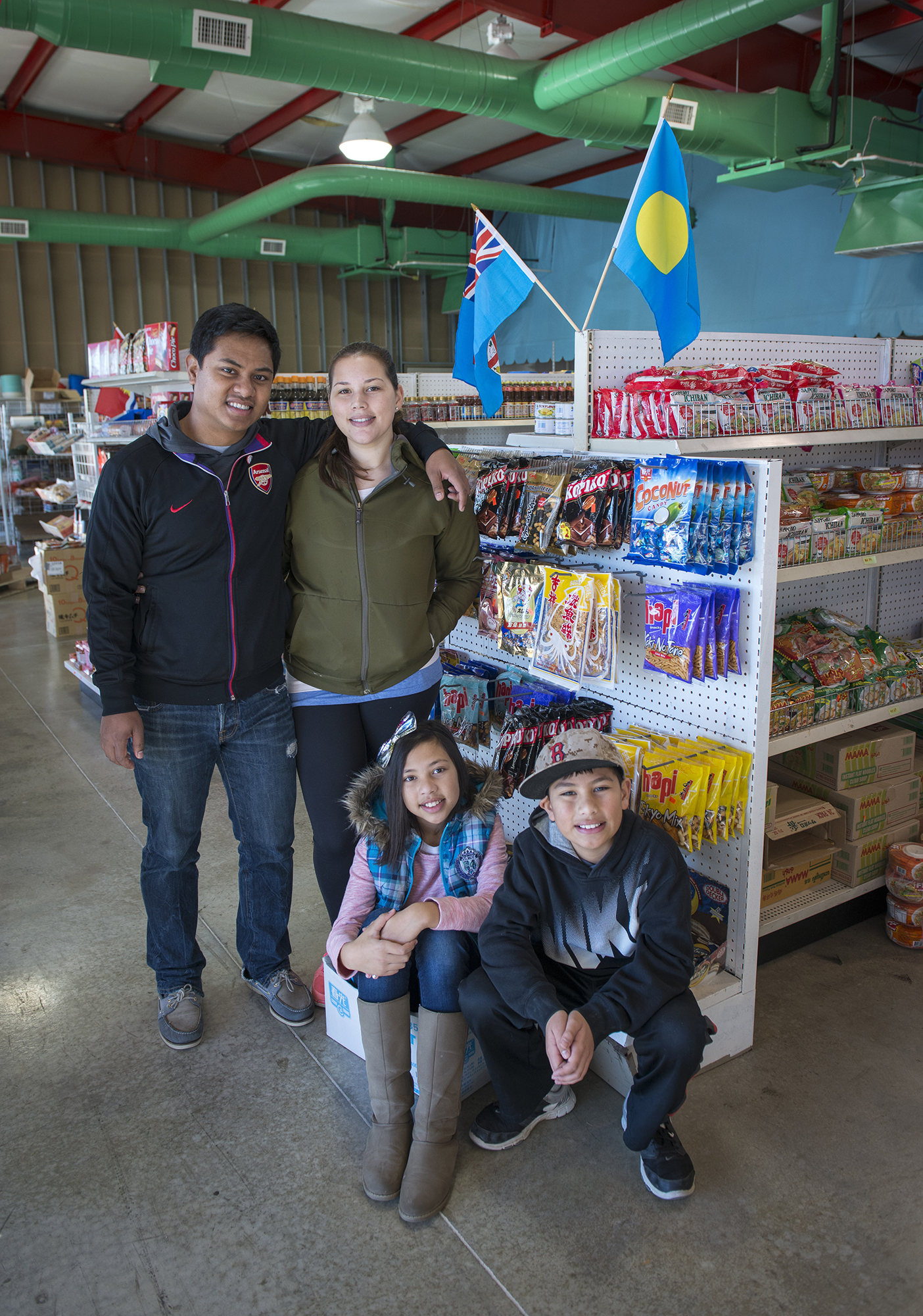 <p>Kevin, Brittney, Brin and Oshen Rehobson at their Micronesian store in Springdale.</p>