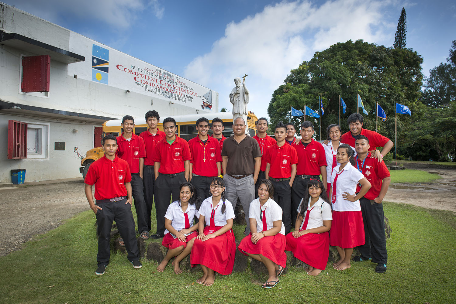<p>Vice Principal Martin Carl with students at Xavier High School, a Jesuit institutionthat produces many leaders.</p>