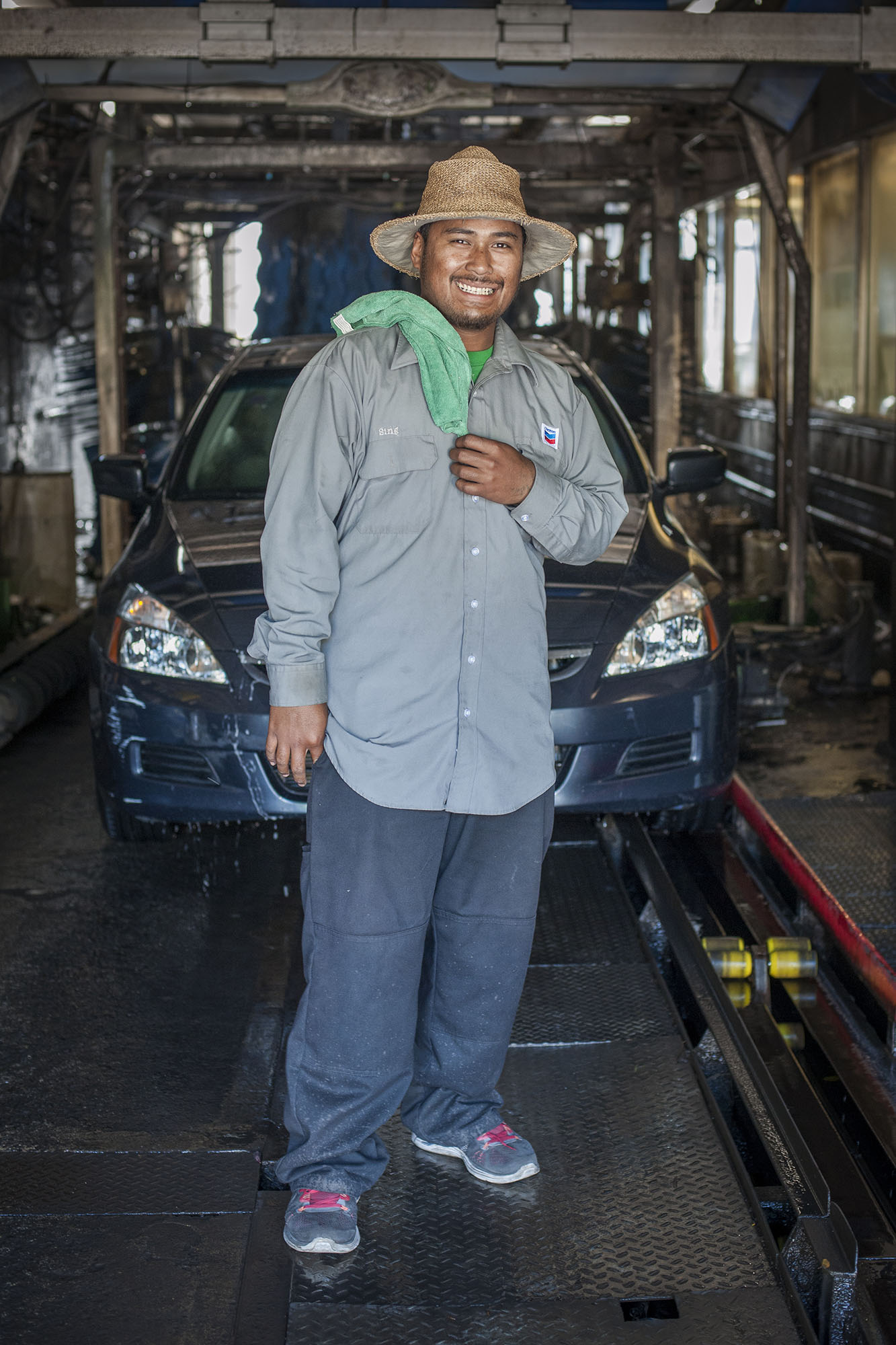 <p>A Micronesian employee at McKinley Car Wash in Honolulu, which employs many people from the island nations.</p>