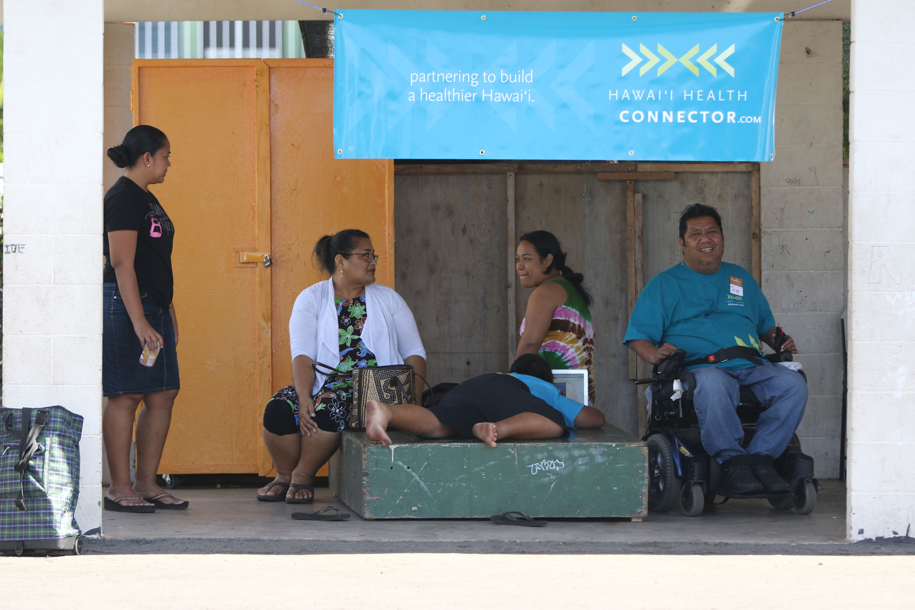 <p>Jojo Peter, right, and Josie Howard, second from left, are two immigrants from Chuuk who have made new lives for themselves in Honolulu. They now lead organizations that are helping other Micronesians assimilate.</p>