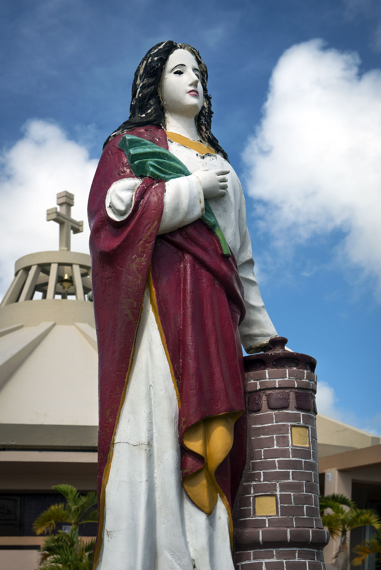 <p>This statuegreets parishioners at the Parish of Santa Barbara on Guam, where Chukeese hold regular services.</p>