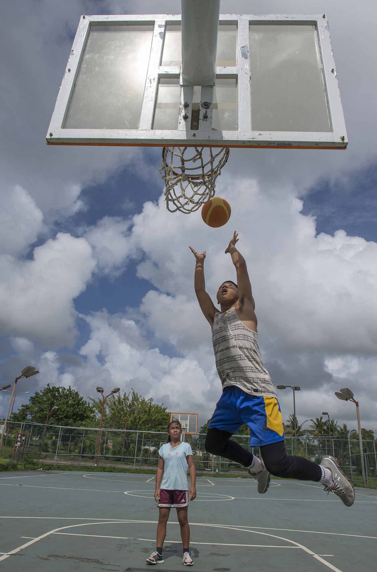 <p>American sports and culture are popular across the Pacific Ocean. Here, locals on Guam shoot some hoops.</p>