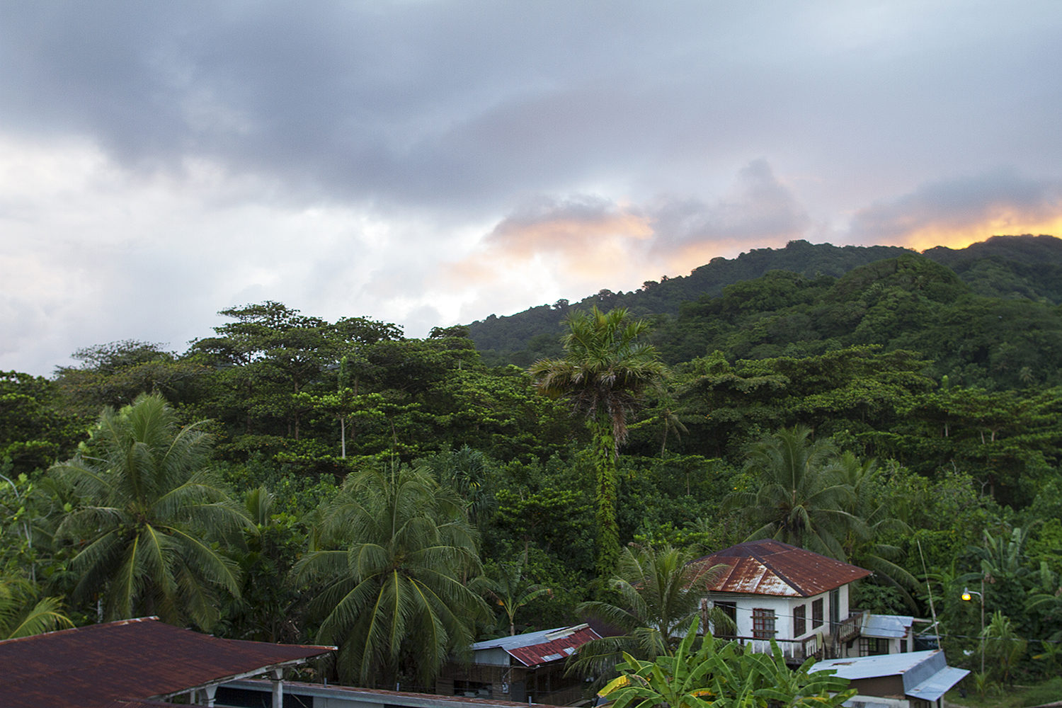<p>A neighborhood in Malem. Micronesian has both low-lying islands and mountainous regions.</p>