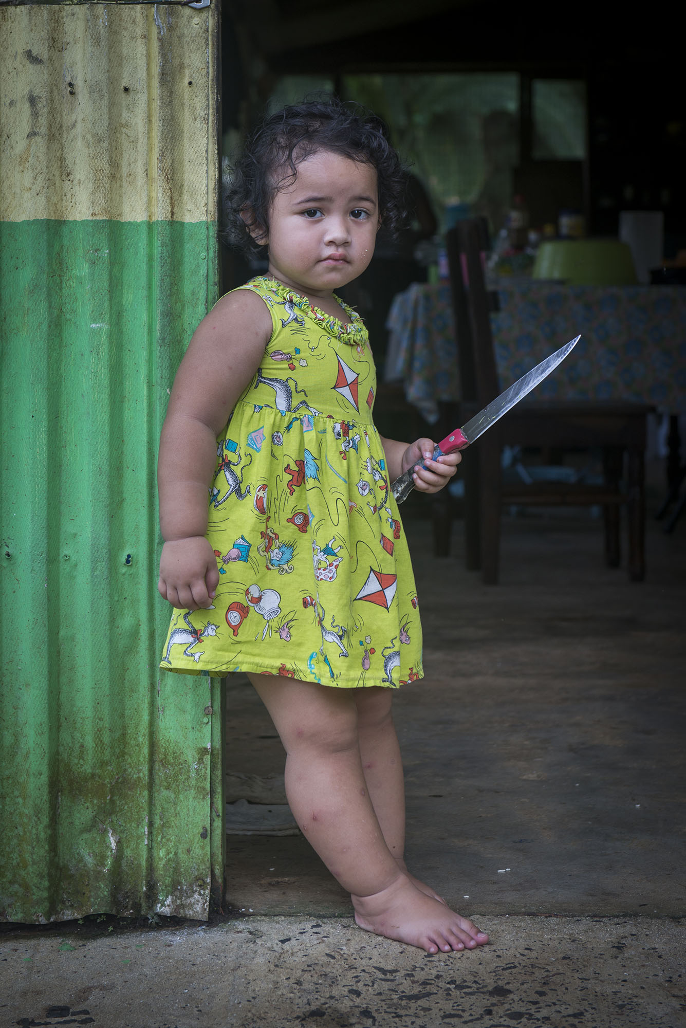 <p>A little girl watches from a doorwayin the rural countryside ofPohnpei in the Federated States of Micronesia.</p>