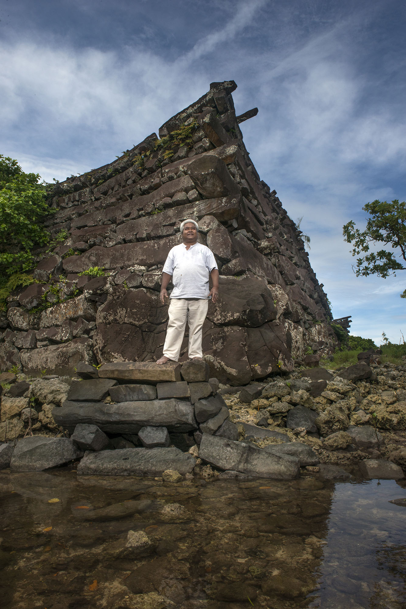 <p>Sam Saul at the the Nan Madol, located not far from his home. The ruined city is onthe eastern shore of Pohnpei and was the capital of the Saudeleur Dynasty until the early1600s.</p>