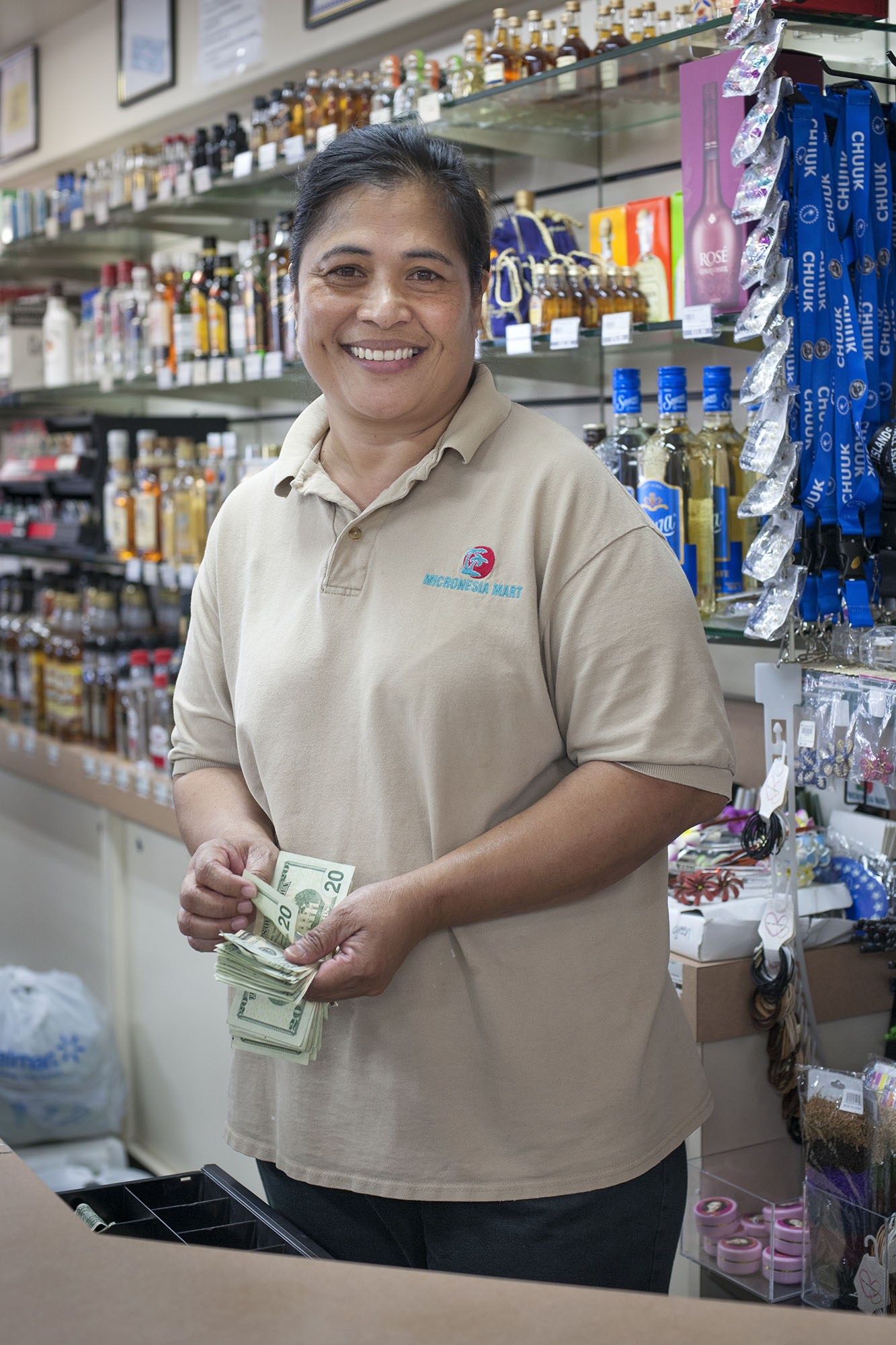 <p>An employee at the Micronesian Mart, which caters to a growing clientele that has moved to Hawaii from Yap, Palau, Chuuk, Pohnpei, Kosrae and the Marshalls.</p>
