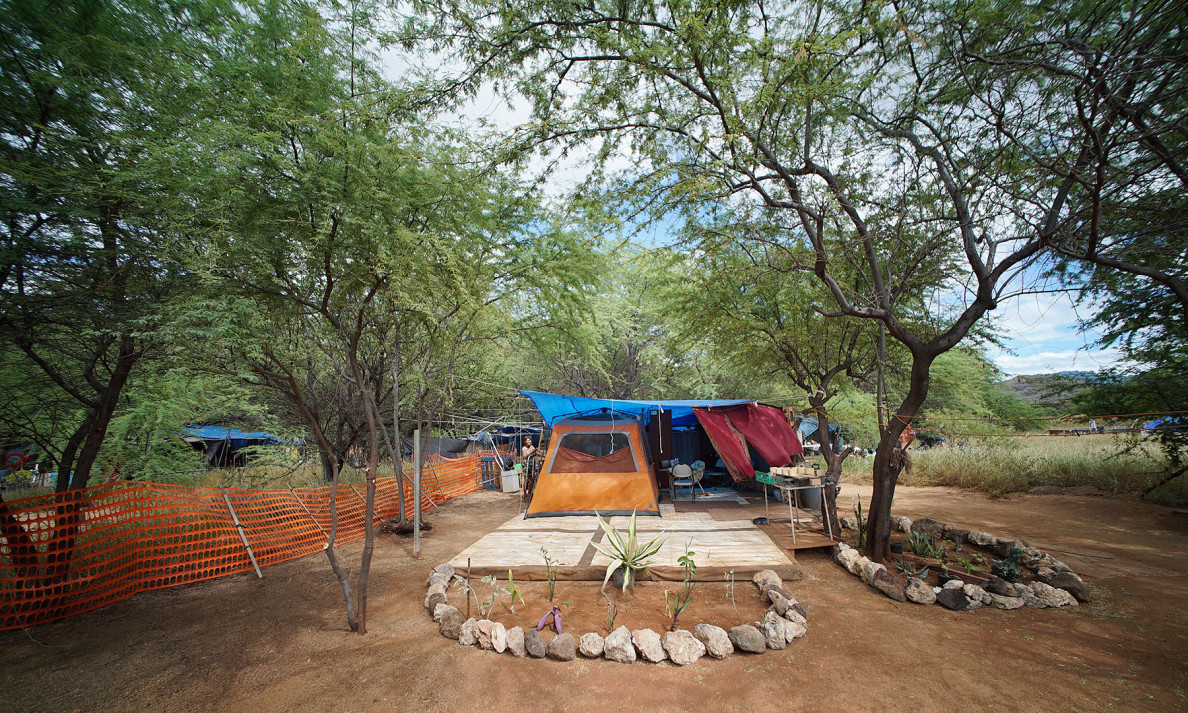 The residents of this camp moved into the site just two months ago. They've spent hundreds of hours making it a home, including adding a bathroom area.