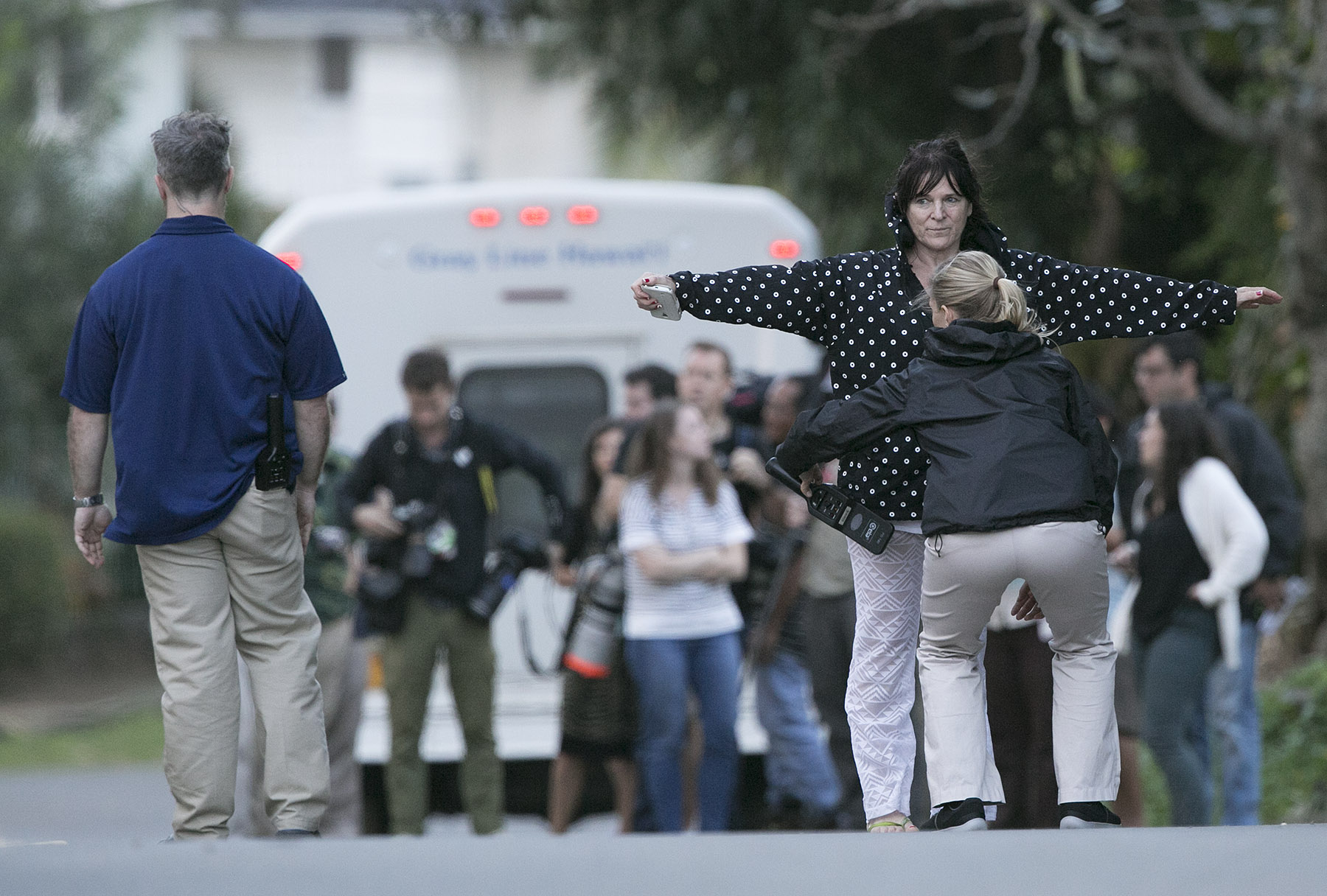 <p>Mid Pacific Country Club is one of the few golf courses Obama frequents on Oahu where the public can catch a glimpse of the president. A Secret Service agent scans a woman near the presidentialmotorcade in December 2015.</p>