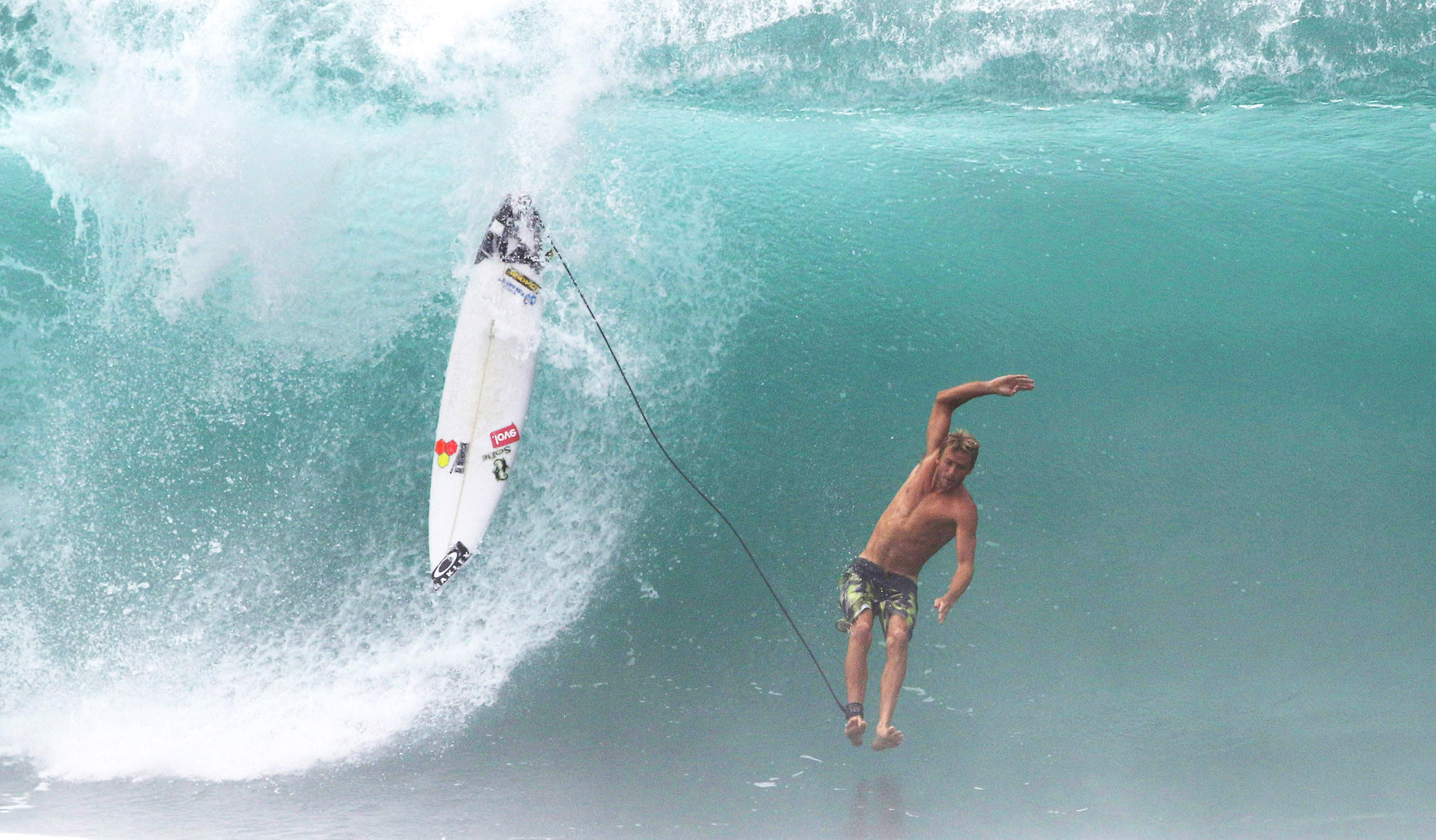 <p>A surfer free-falls after being separated from his board as waves pound the Banzai Pipeline during a North Shore competition that coincided with high surf warnings in early December.</p>