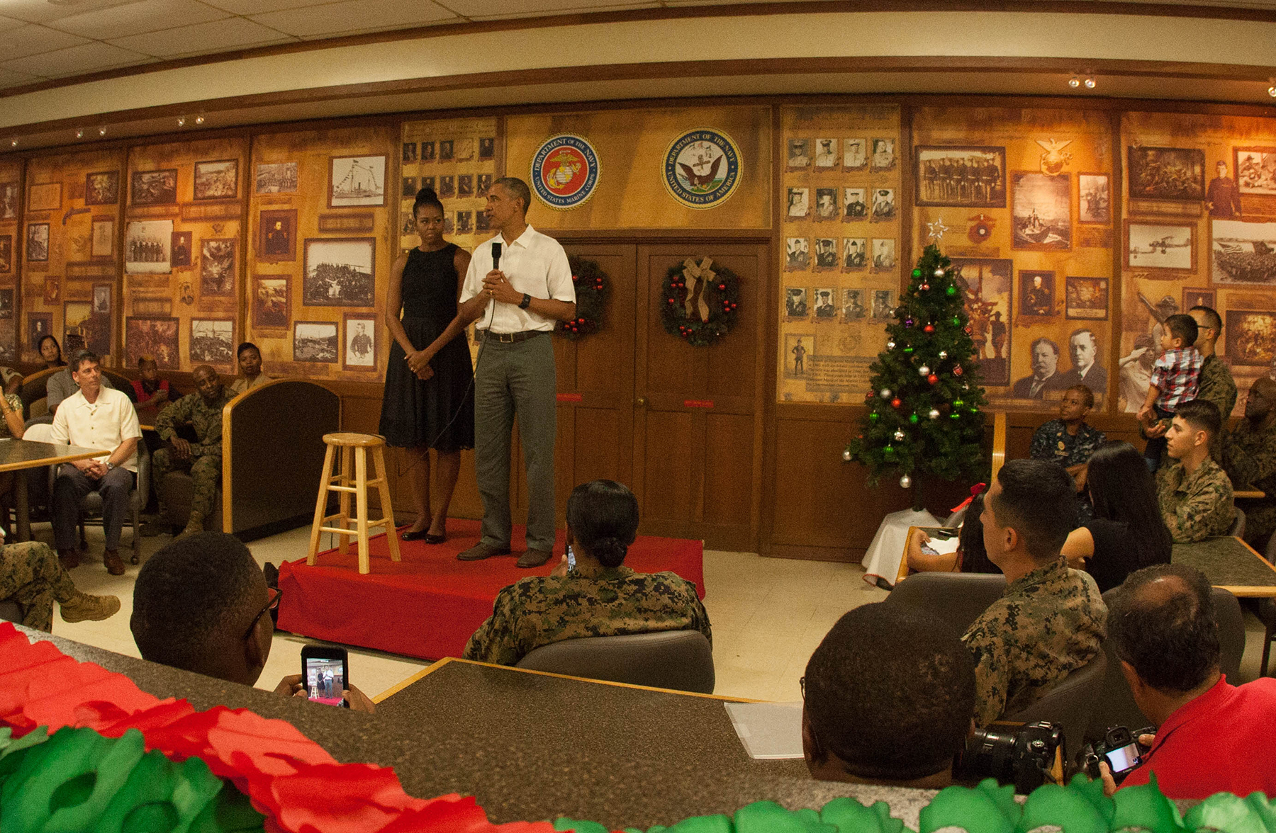<p>Continuing a Christmas Day tradition, Barack and Michelle Obama speak to service members and their families at Marine Corps Base Hawaii in Kaneohe before mingling with the attendees for photo opportunities.</p>