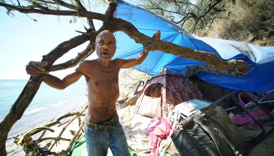 Diamond Head slopes homeless Michael Oliver stands near his tent. Denby story.