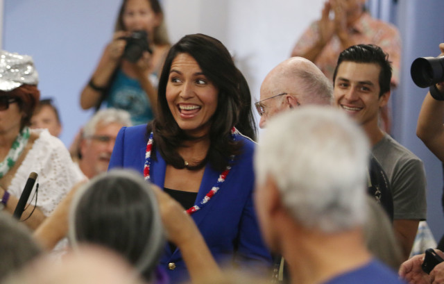 Congresswoman Tulsi Gabbard as she enters Church of the Crossroads meeting room before Jane Sanders is introduced.