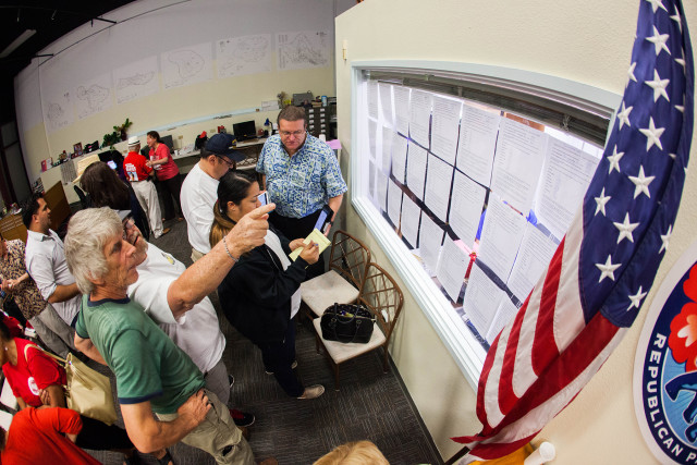 Posting the votes at Republican Party headquarters Tuesday night.