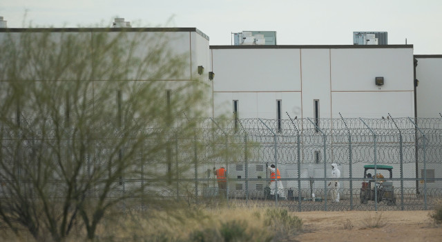 Saguaro Correctional Facility. People walking around inside of fences. Eloy, Arizona 6 march 2016. photograph Cory Lum/Civil Beat