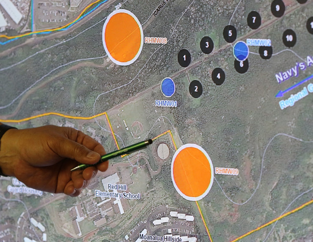 Board of Water Supply Ernest Lau points to areas near the Navy's 20 fuel tanks below Red Hill by the black dot looking things below his left hand during EPA teleconferenced meeting with the BWS board. 28 june 2016