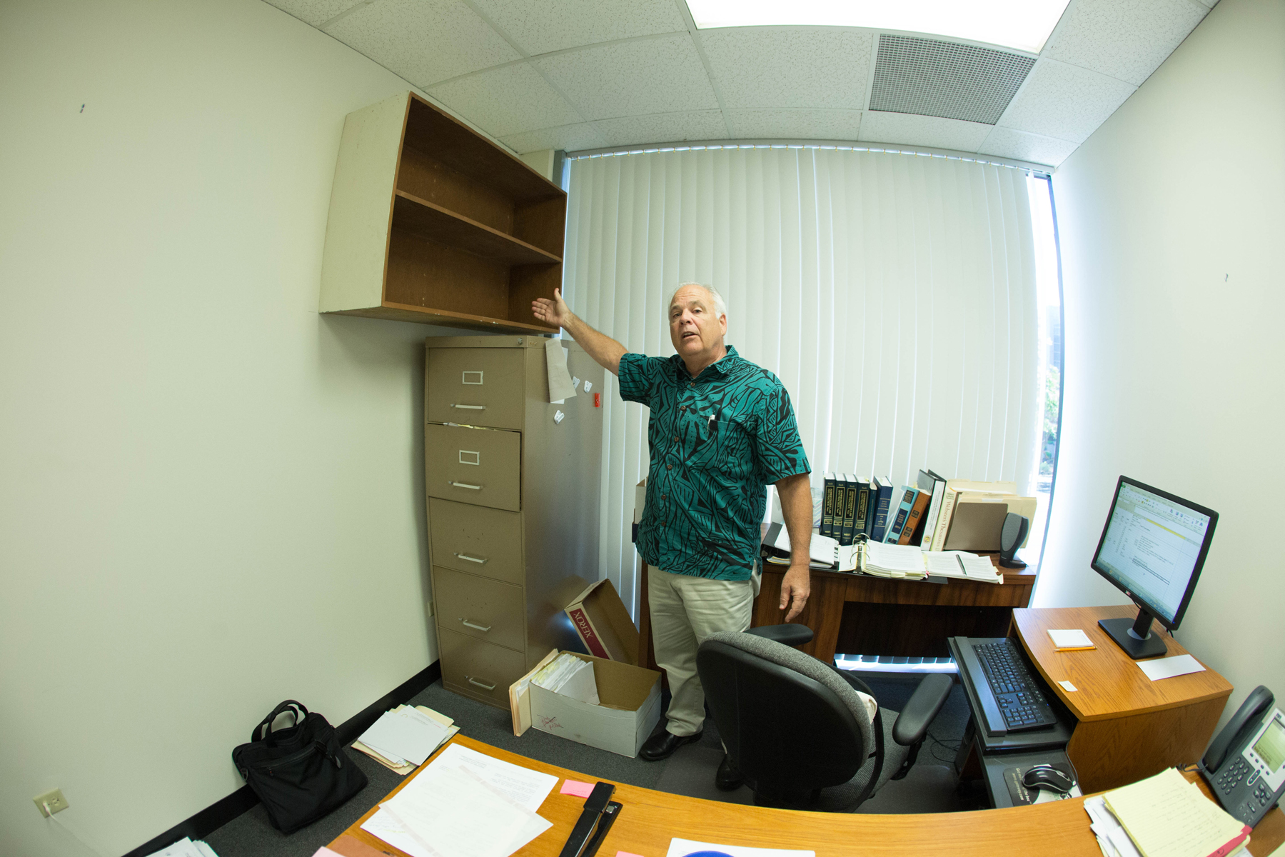 <p>June 7: Honolulu Ethics Commission Director Chuck Totto clears out his office during one of his final days on the job. Commission members forced him out after ongoing quarrels between Totto and the administration of Mayor Kirk Caldwell. <em>Anthony Quintano/Civil Beat</em></p>