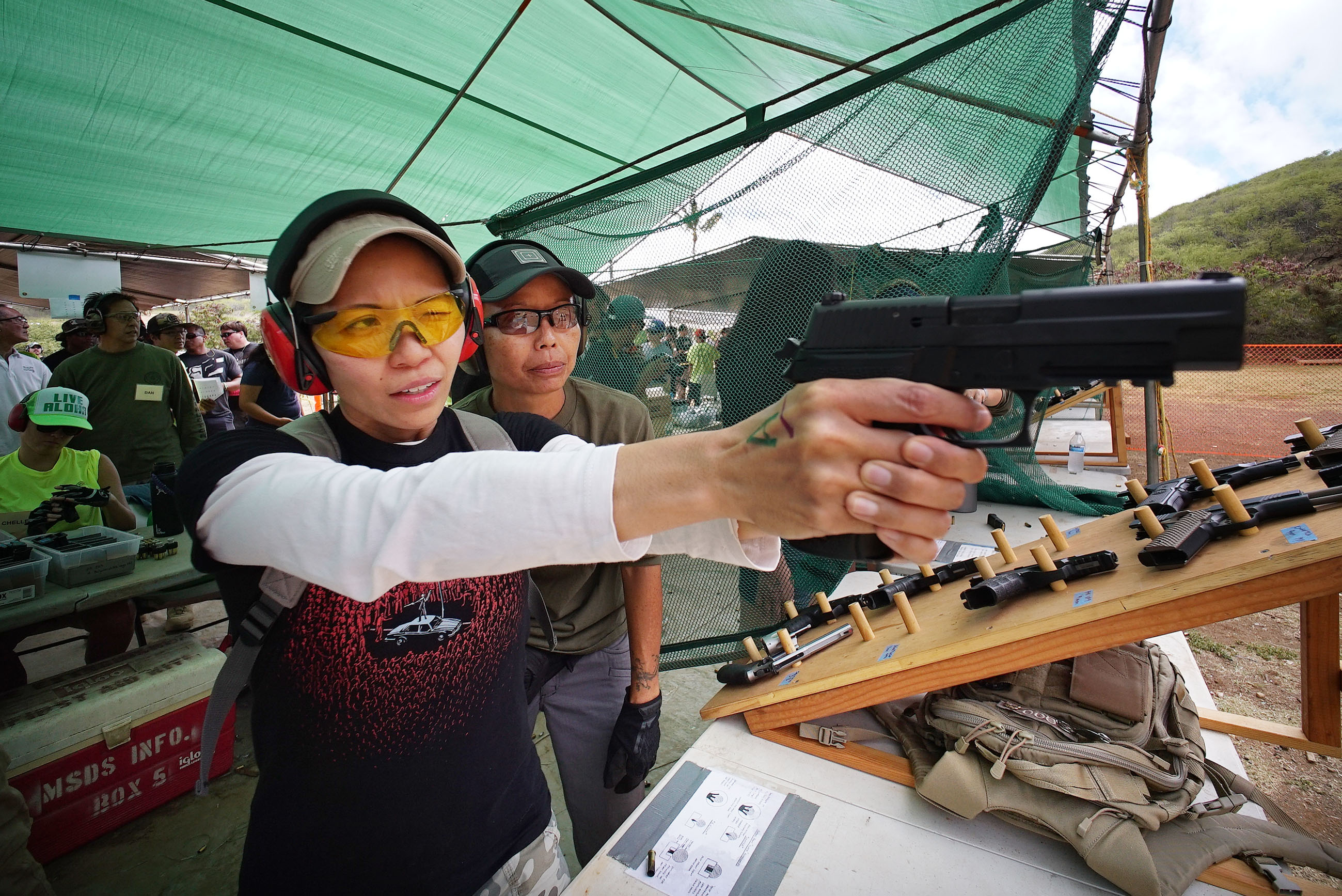<p>Christy Agena of Kaneohe took aim with a handgun.</p>