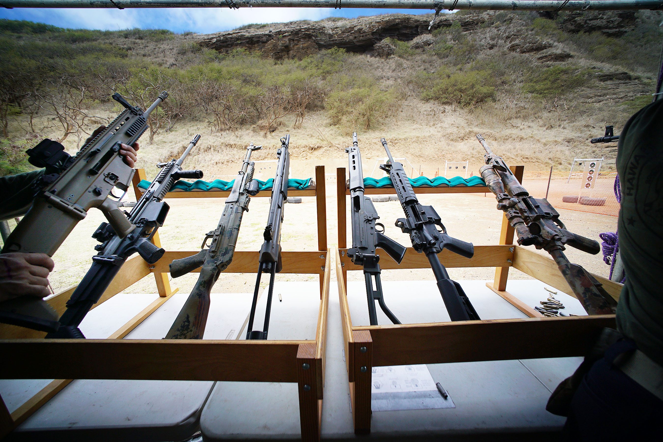<p>An array of rifles awaited visitors to the Hawaii Rifle Association's 23rd annual Shooting Sports Fair at the Koko Head Shooting Complex last weekend.</p>