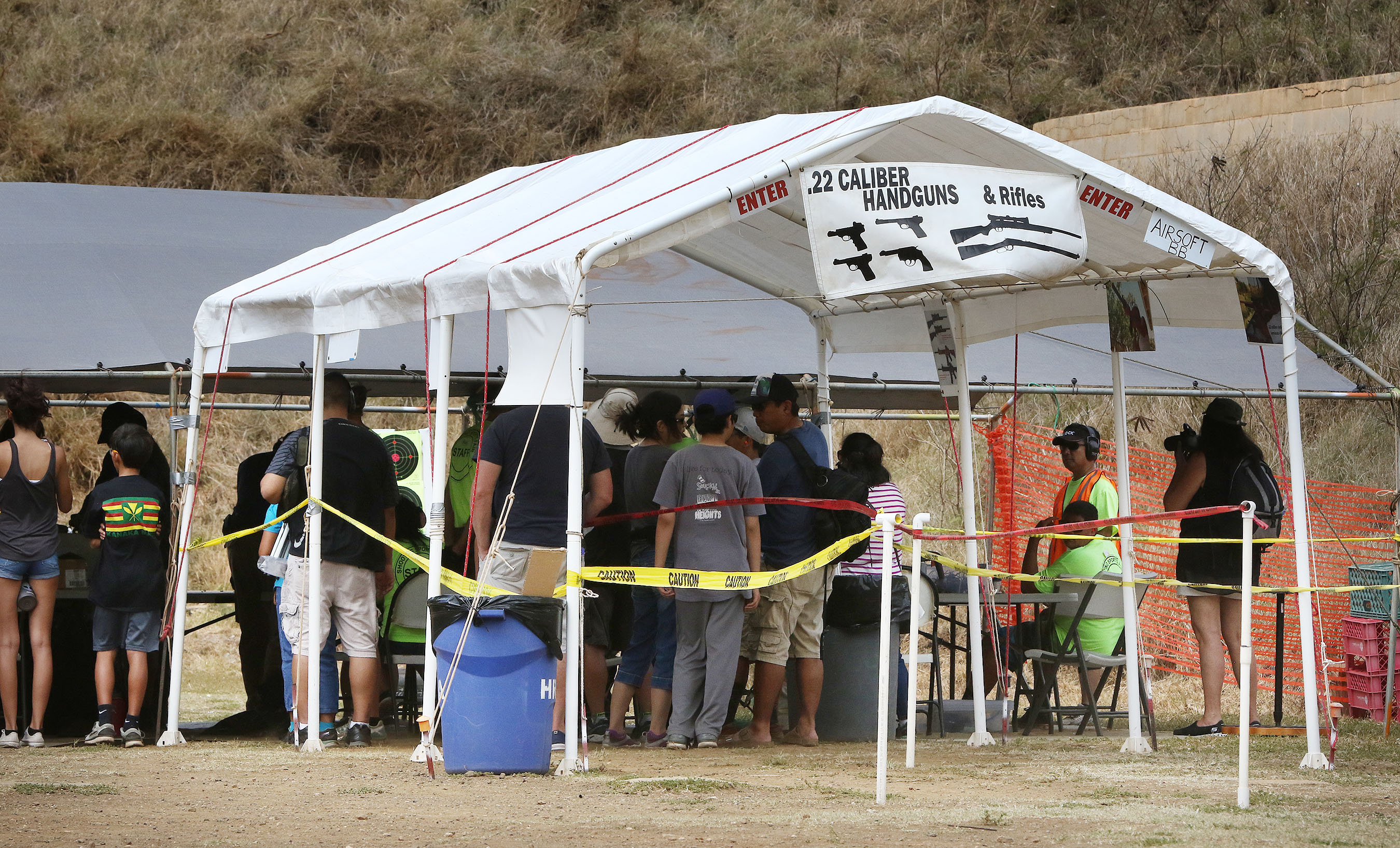 "<p>Scores of people gathered in Hawaii Kai to fire guns at the 23rd annual event. The list of available weapons included tactical shotguns, big game rifles and ""military small arms,"" according to promotional material.</p>"