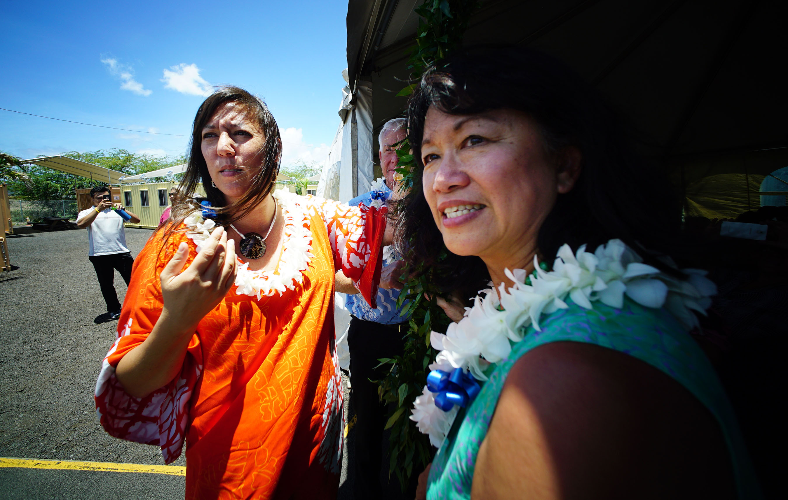 <p>Even though the shelter had been open for 220 days, the event was considered a grand opening. IHS Executive Director Connie Mitchell, right, and IHS Chaplain Terry Yasuko Ogawa prepared to untie the maile lei.</p>