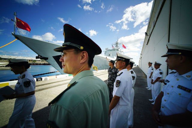 Officers from the People Liberation Army Navy fronting Chinese navy ship Xian at Pearl Harbor during a day open to media. The Xian is one of 3 ships participating in RIMPAC. 2016 july 8