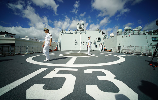 Officers from the People Liberation Army Navy on the Chinese navy ship Xian DD 153 at Pearl Harbor during a day open to media. The Xian is one of 3 ships participating in RIMPAC. 2016 july 8