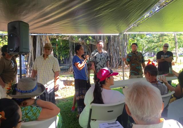 Katie Kamelamela holds the microphone as Makana Paris, Zuri Aki and Clifford Kapono await their turn to speak.