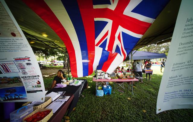La Hoihoi Ea festival Thomas Square (Hawaiian flag day) as a Hawaiian flag blows in the wind. 30 july 2016