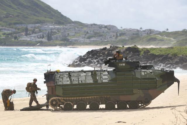 US Marines Amphibious Assault Vehicle rolls onto the sands at Pyramid Rock, Marine Corps Base Hawaii. Kaneohe Hawaii. 30 july 2016