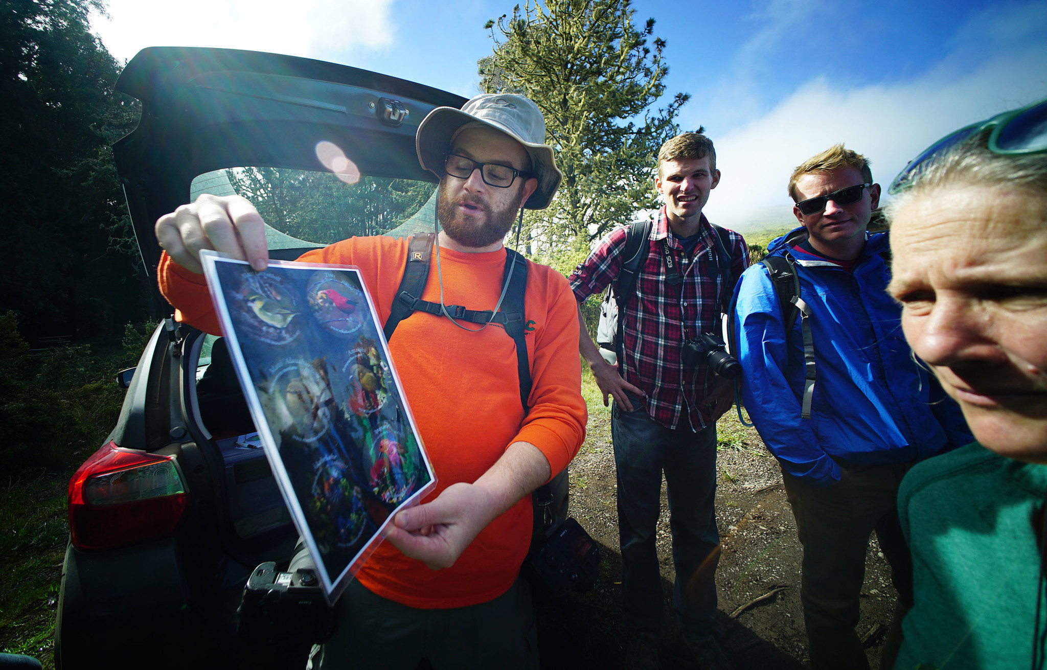 <p>Bryan Berkowitz, a docent withThe Nature Conservancy of Hawaii, previewed some of the rare birds hikers were hoping to see during their July 9 visit. First they hadto scrub their shoes with bleach to prevent the spread of a tree-attacking disease known as rapid ohia death.</p>