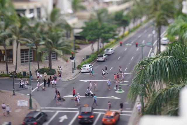 Pedestrians use crosswalks on Kalakaua Avenue at the Kanekapolei Street intersection, near the Hyatt and Moana Hotels. 31 july 2016