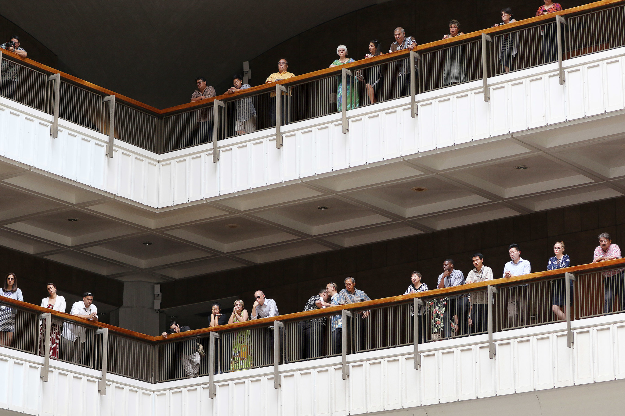 <p>Mourners watch the service from the Capitol's upper floors. Hundreds filled the seats and standing room on the Rotunda floor below.</p>