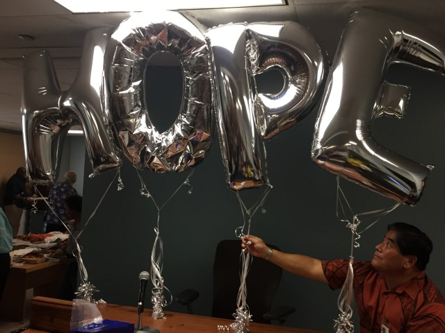 United States Marshall Gervin Miyamoto adjusts the balloons in place for Judge' Alm's retirement party at 1st Circuit Court in Honolulu.