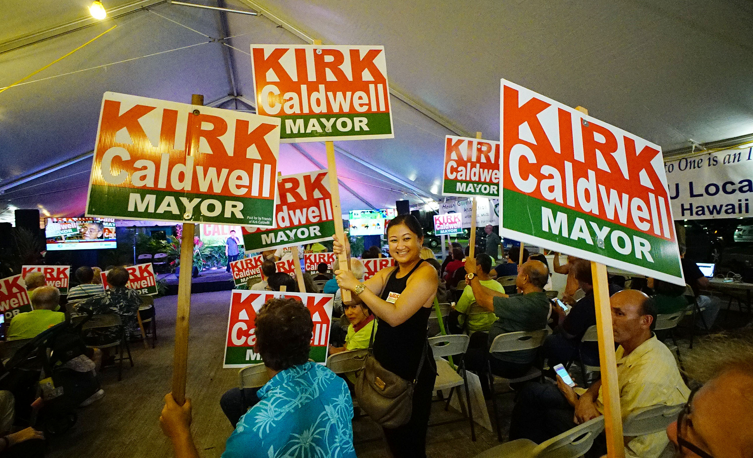 <p>When the first returns were announced, supporters of Mayor Kirk Caldwell celebrated his early lead at campaign headquarters on Nimitz Boulevard. (Civil Beat/Cory Lum)</p>