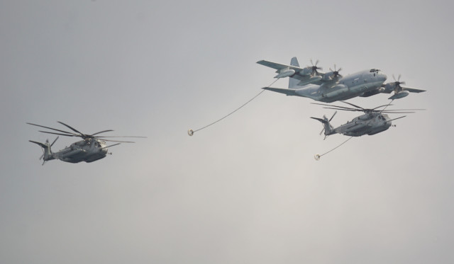 RIMPAC KC-130 Hercules flanked by CH-53E Helicopters. The KC-130 ca carry more than 12,000 gallons of fuel and simultaneously refuel two aircraft at 300 gallons of fuel per minute. 30 july 2016