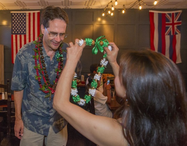 Hawaii Senate District 13 Candidate Karl Rhoads is given a lei while spending time with his supporters at the Square Barrels Craft Burgers and Craft Beers bar Saturday, Aug. 13, 2016, in Honolulu. Photo by Eugene Tanner