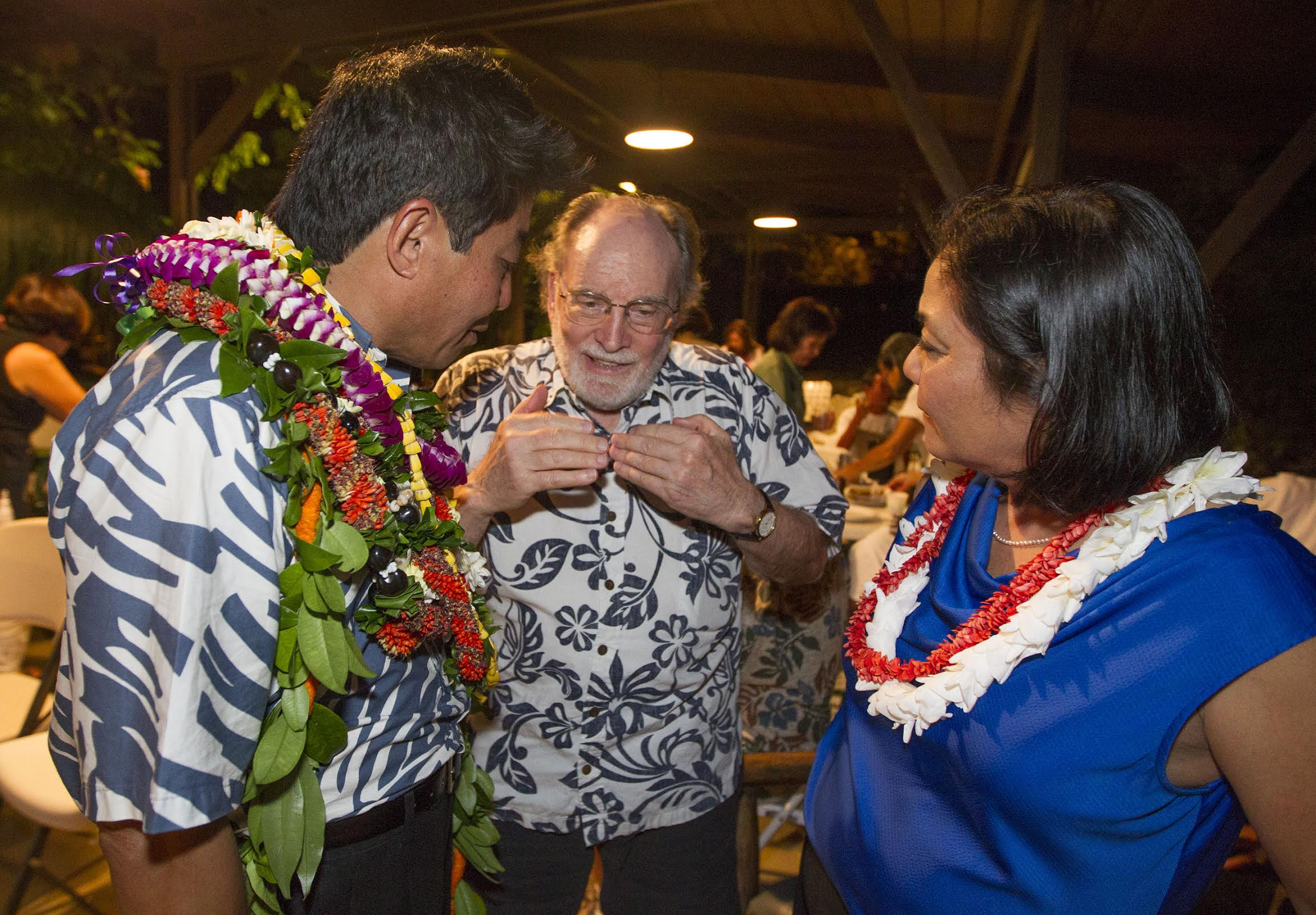 <p>Dale Kobayashi, left, and his wife, Dawn, got words of encouragement from former Gov. Neil Abercrombie. Kobayashi was locked in a tight race all night in the Democratic primary for House District 23, but narrowly lost to incumbent Isaac Choy. (Eugene Tanner/Civil Beat)</p>