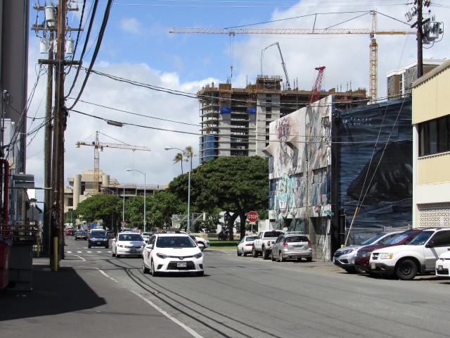 Murals can be seen outside the buildings along Pohukaina Street.