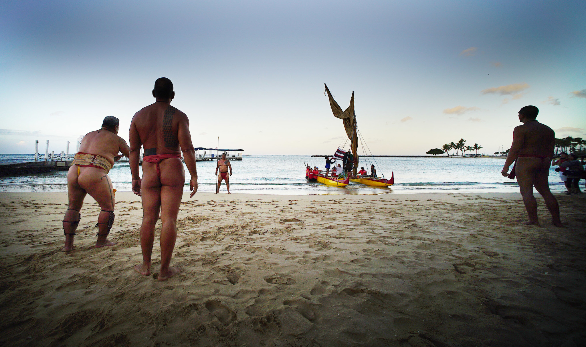 <p>In an event heralding the first morning of the World Conservation Congress, a double-hulled canoe arrived Thursday on Waikiki Beach and was greeted by men in malo — traditional Hawaiian warrior garb — who threw a spear and presented a welcoming gift of a coconut plant.</p>