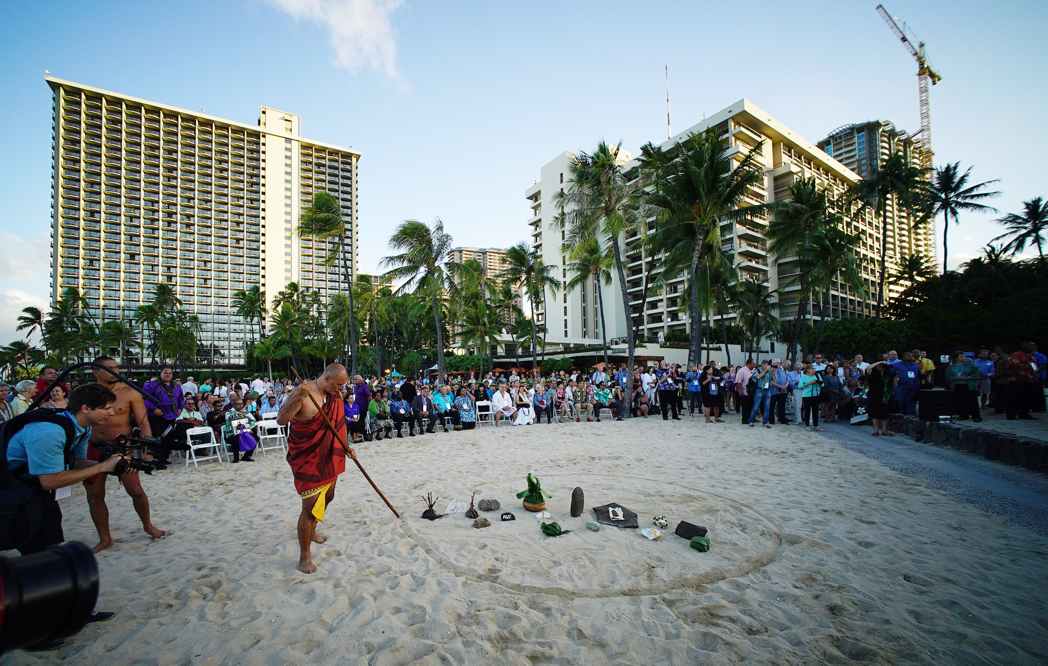 <p>Welcoming gifts from Pacific Island leaders filled a circle in the sand in a ceremony watched by people who then moved on to the Neal S. Blaisdell Center for a continuation of opening-day events.</p>