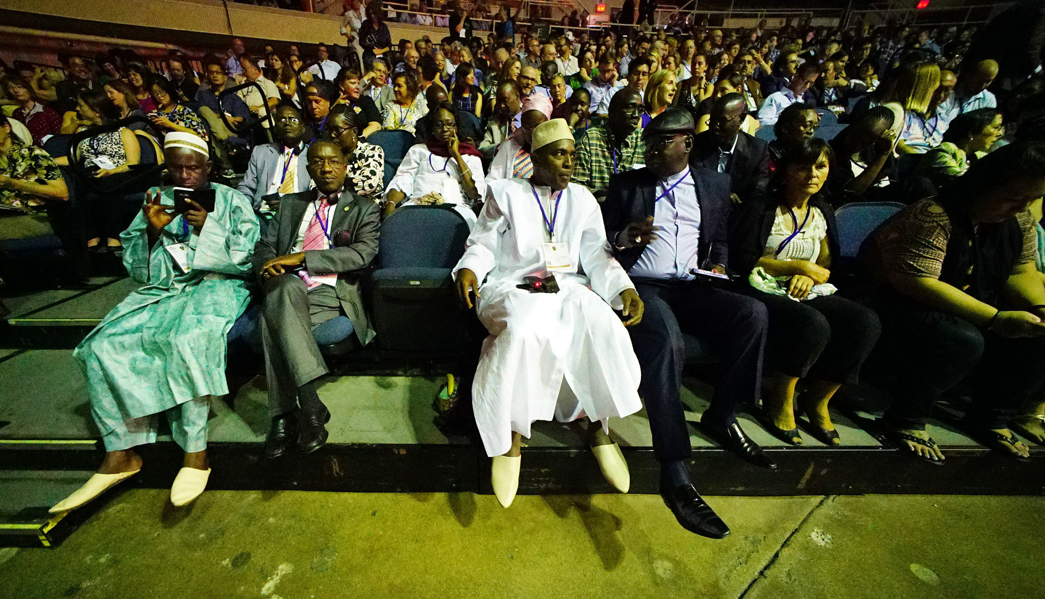 <p>World Conservation Congress delegates with front-row seats relaxed before the ceremonies began.</p>