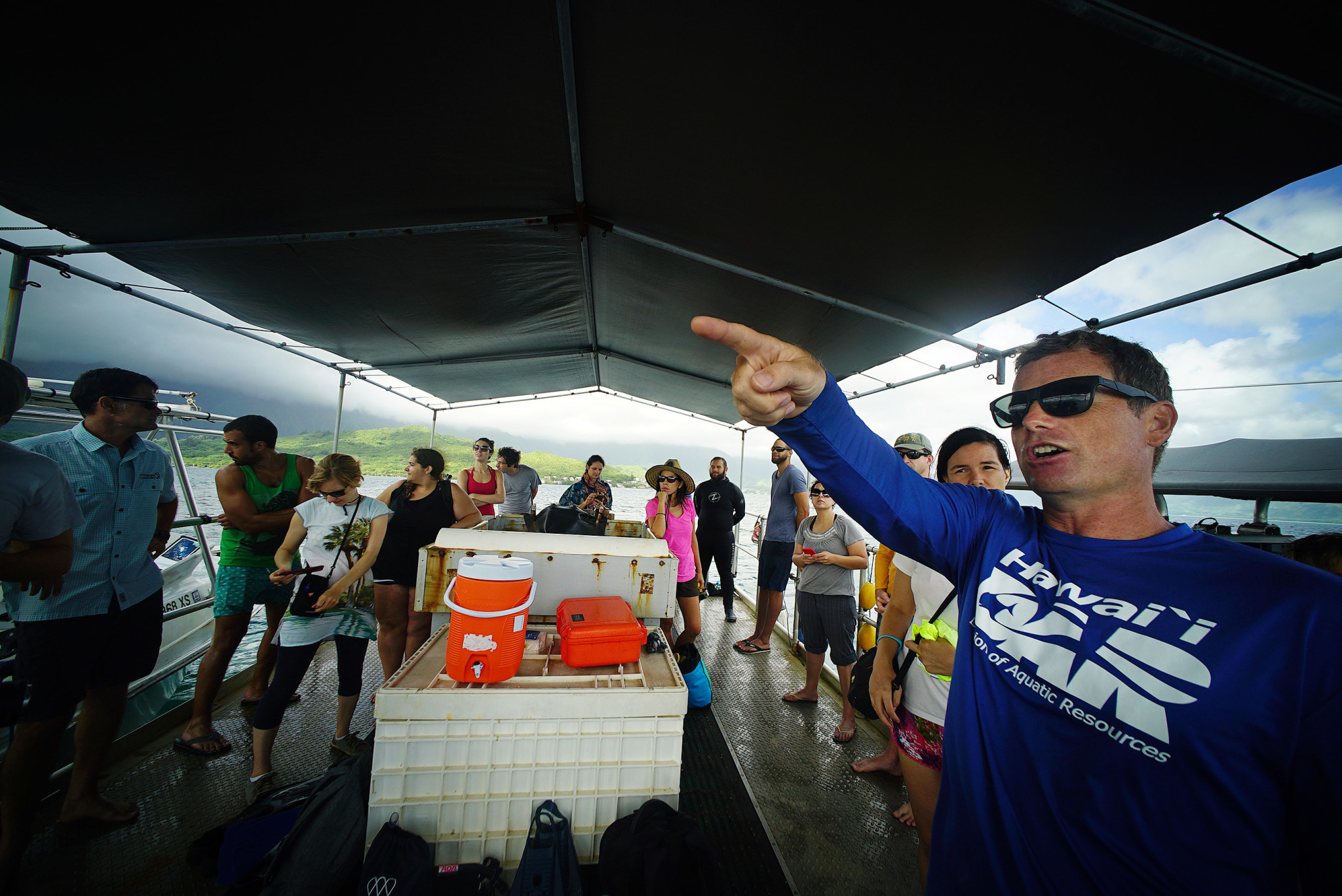 """<p>DLNR officials said the state will look to get rid of algae that has taken root on Hawaii's coral by bolstering local fish populations through various restrictions that might limit catch. As DLNR aquatic biologist Brian Neilson, right, said, """"We love to see herbivores on the reef because they love to eat the algae.""""</p>"""