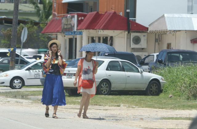 Saipan Middle Road Garapan future casino as tourists/visitors walk down Middle Road in the sweltering humidity and heat. 24 aug 2016