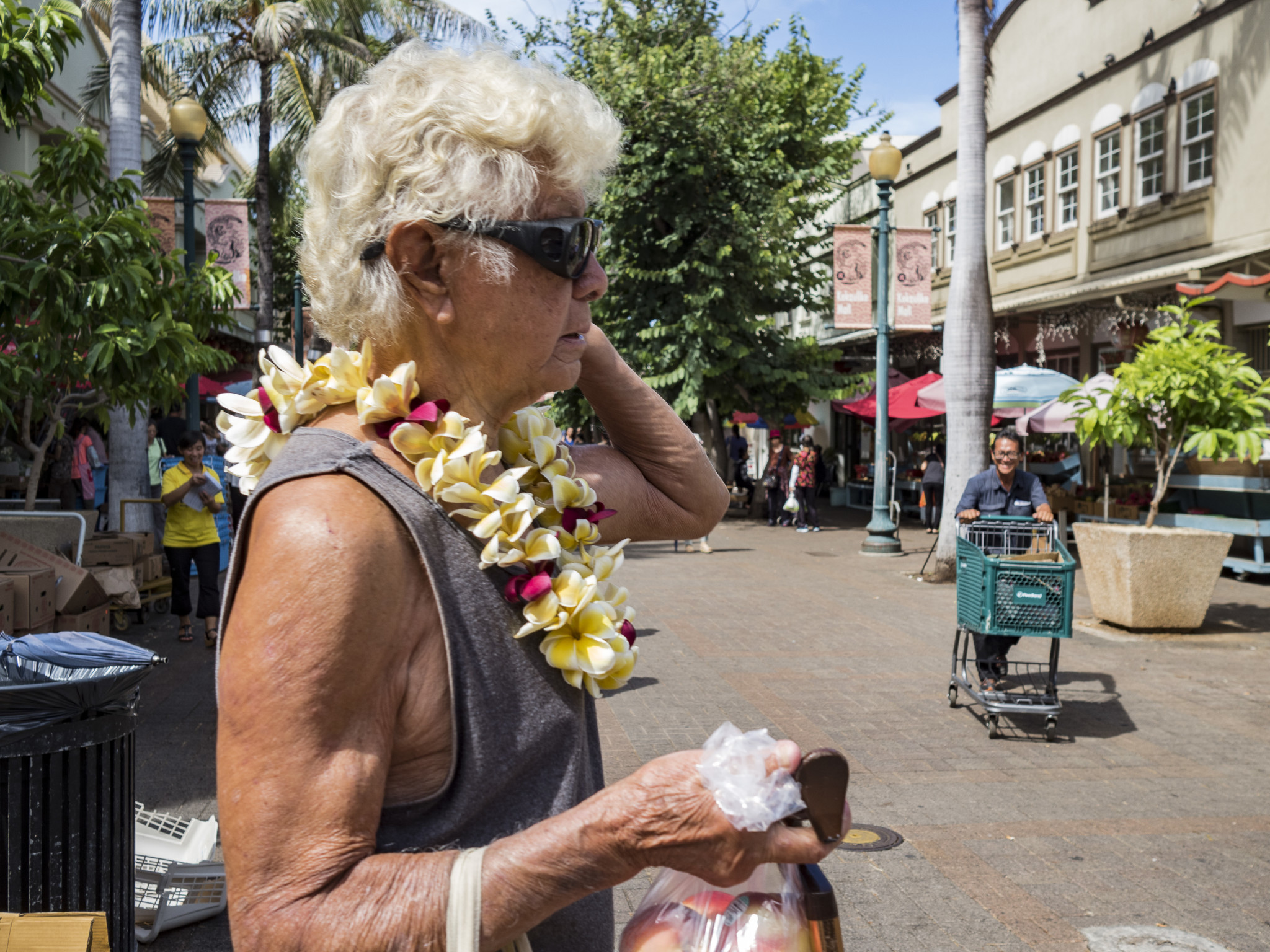 <p>A local woman sports a plastic lei. She is a regular customer in Chinatown.</p>