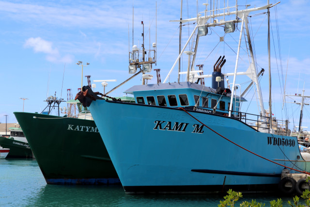 Two longline fishing vessels are ported in Honolulu.